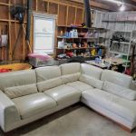 White leather couch after repair and restoration.