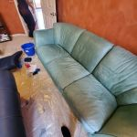 Photo of leather Natuzzi couch before restoration