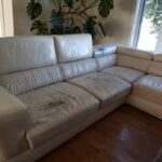 Picture of worn and scratched white leather sectional