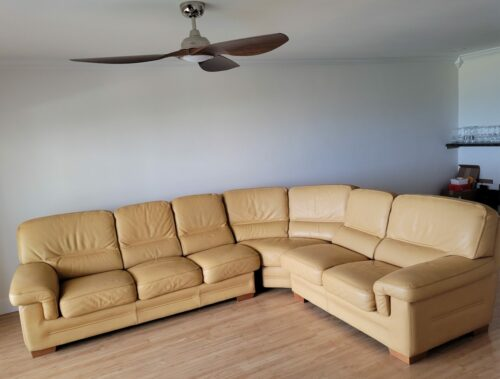 Picture of sun faded and stained aniline leather sectional refinished with a Custom RubnRestore Color