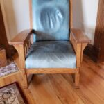 Picture of faded and stained blue aniline leather chair