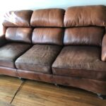 Picture of faded brown leather couch
