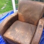 Dirty leather club chair before restoration