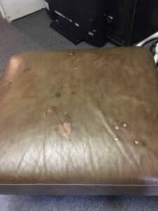 Picture of discolored brown leather ottoman