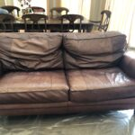 Faded and worn leather sofa