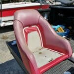 Picture of faded red marine vinyl captain's chair in boat