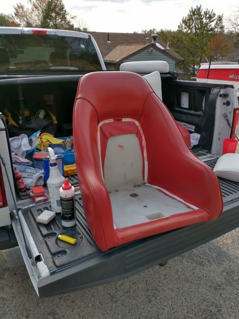 Photo red marine vinyl captain's chair in boat restored with Rub n Restore