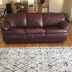 Picture of reddish brown leather couch before restoration