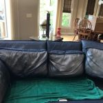 Leather couch being restored.