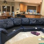 Leather couch after restoration with midnight blue color.