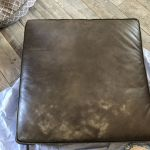 Picture of worn, discolored brown leather couch cushions