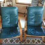 Leather chairs that have been colored with turquoise dye.