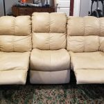 Pictuer of beige leather couch with recliner chairs