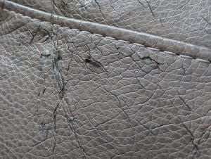 Image of hairline cracks in bonded faux leather