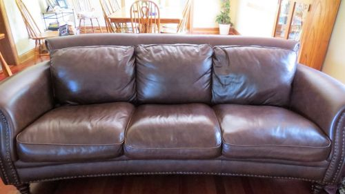 Brown leather couch after patching and restoration.