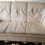 Picture of dirty, worn off-white leather sofa