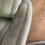 Cracked leather on arm needs repair with filler