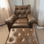 Picture of dad's tufted leather chair and ottoman with cracking finish