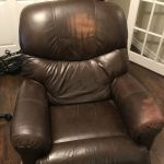 Picture of discoloration and fading on head and arm on brown leather recliner chair