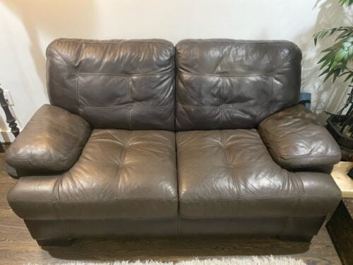 Picture of worn leather loveseat restored with Espresso RubnRestore