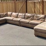 Picture of giant leather sectional before repair and restoration