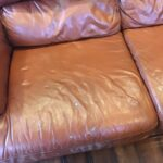 Picture of holes and tears on leather couch