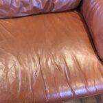 Photo of hole on leather loveseat