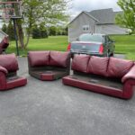 Picture of used red leather sectional before