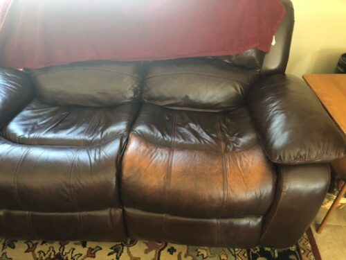 Picture of discolored brown leather couch