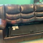Before photo of a leather couch needing repair