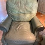 Picture of worn alligator skin leather chair