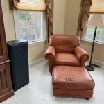 Picture of faded red leather club chair and ottoman