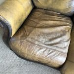 Picture of worn cushion on leather couch