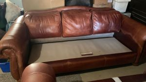 Picture of leather sofa damaged by mineral deposits after cleaning