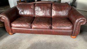 Picture of leather sofa damaged by mineral deposits after restoration
