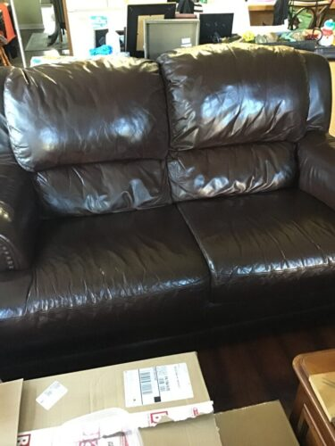 Picture of leather loveseat after Mahogany RubnRestore