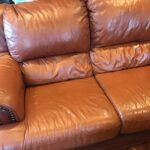 Picture of leather loveseat before