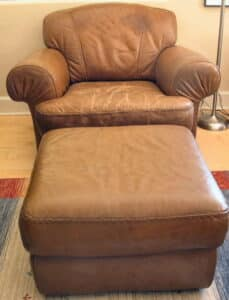 Picture of leather ottoman repaired with filler and refinished with Rub n Restore