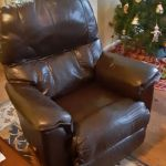 Leather recliner with discoloration at head