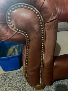 Photo of leather couch arm after cleaning removing mineral deposits