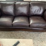 Picture of leather sofa damaged by cleaner chemical