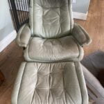 Picture of faded and stained Italian leather stressless chair and ottoman