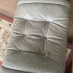 Picture of stained and faded leather ottoman