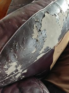 Image of bonded leather couch peeling, hydrolysis related failure