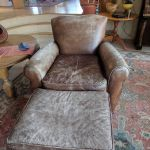 Picture of worn and torn leather chair and ottoman