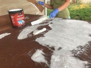 Image of applying Liquid Rubber sealant to damaged marine vinyl hot tub cover